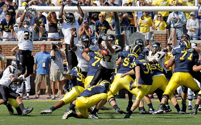 Corey Lynch blocks Michigan's field goal to seal the upset. (Mark Campbell/College Sporting News)