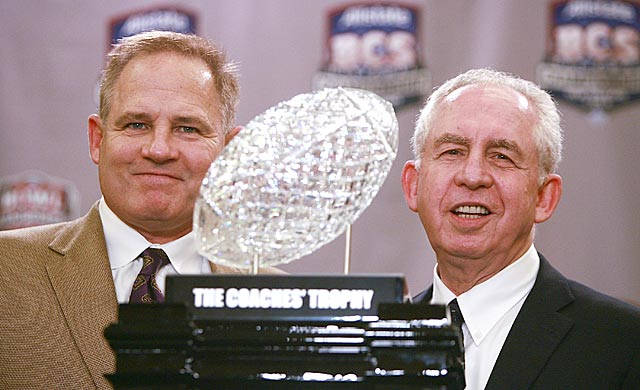 SEC commish Mike Slive (right) probably will be posing with the BCS title trophy again in January. (Getty Images)