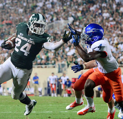 Le'Veon Bell stiff-arms a Boise State defender on his way to a touchdown in the fourth quarter.  (US Presswire)