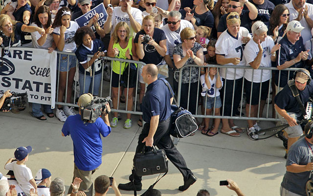 Penn State fans cheer as Bill O'Brien arrives for his first game as Nittany Lions coach. (AP)