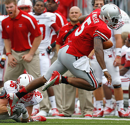 Braxton Miller sets an Ohio State record for quarterbacks with 161 yards rushing, including a 65-yard TD run.  (Getty Images)