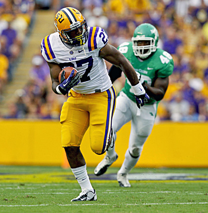 LSU's Kenny Hilliard, who rushes for 141 yards and two TDs, scores on a five-yard run. (US Presswire)