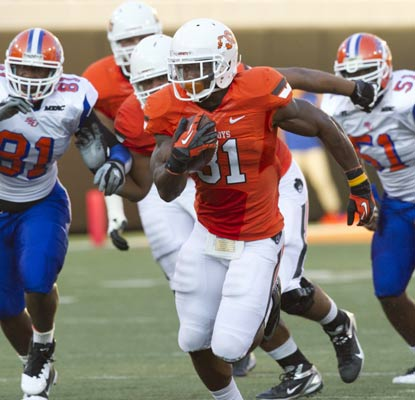 Jeremy Smith leaves Savannah State in the dust for three touchdowns in a laugher in Stillwater.  (US Presswire)