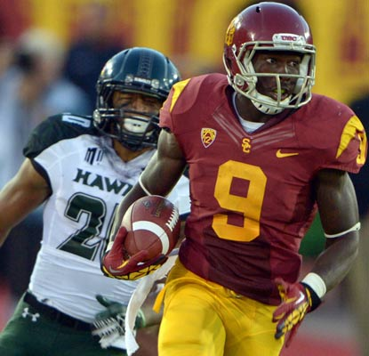 Marqise Lee has a quite a day against Hawaii with 197 yards receiving and two touchdowns, one on a 100-yard kickoff return.  (US Presswire)
