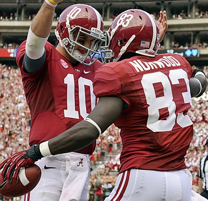 AJ McCarron celebrates after one of his two TD passes to Kevin Norwood, who has three catches overall for 92 yards.  (US Presswire)