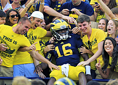 Denard Robinson celebrates after accounting for four touchdowns in Michigan's win over the Air Force. (AP)