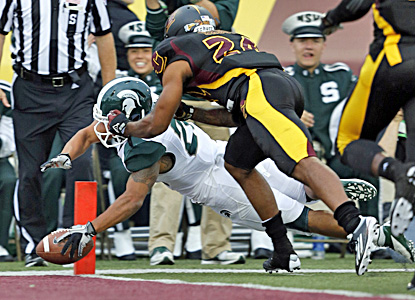Michigan State's Nick Hill dives for the end zone during the Spartans' 41-7 win. (AP)