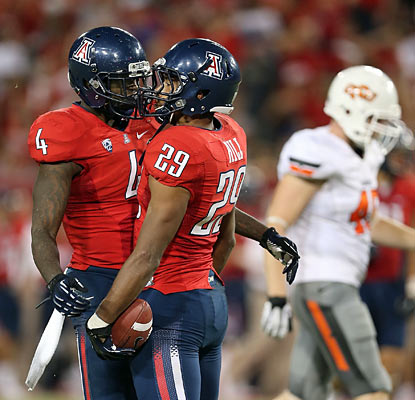 Austin Hill (right) chats it up with a teammate after hauling in a 44-yard reception. He finishes with 124 yards on the day. (Getty Images)