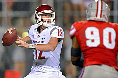 Connor Halliday, starting in place of injured Jeff Tuel, throws four first-half touchdown passes for the Cougars. (US Presswire)