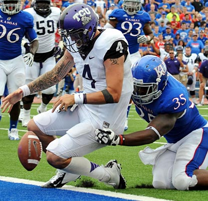 TCU QB Casey Pachall fumbles three times against Kansas, including this giveaway near the goal line.  (US Presswire)