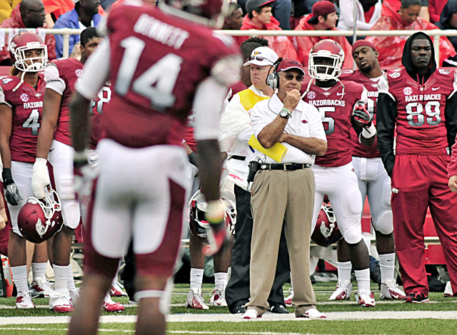 Arkansas coach John L. Smith watches as he endures the worst loss of his career. (AP)