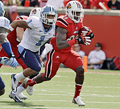 Louisville's Jeremy Wright breaks away for some of his 114 rushing yards against North Carolina.  (AP)