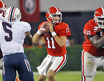 Aaron Murray throws for 342 yards, two touchdowns and rushes for two more in Georgia's win over FAU. (AP)