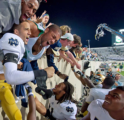 The Irish bask in the glory with Notre Dame fans who come out to watch their team improve to 3-0 on the season. (US Presswire)