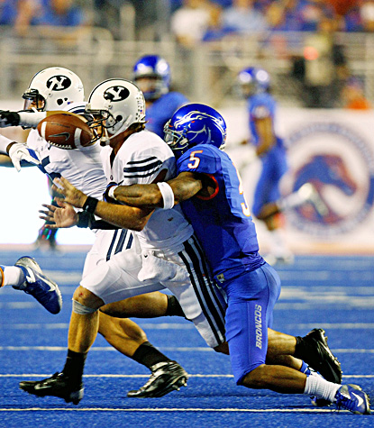 Boise State's Jamar Taylor (right) knocks the ball out of the hands of BYU quarterback Riley Nelson in the Broncos' win. (US Presswire)