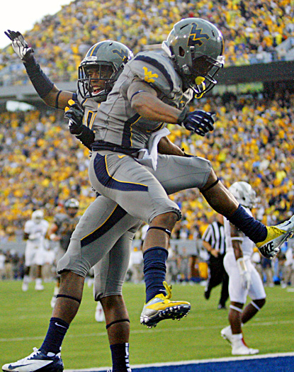 Jordan Thompson celebrates with Tavon Austin (right) after Austin scores one of his three TDs. (US Presswire)