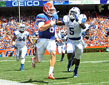 Florida's Jeff Driskel (two touchdowns) runs for some extra yards in the win over Kentucky. (US Presswire)