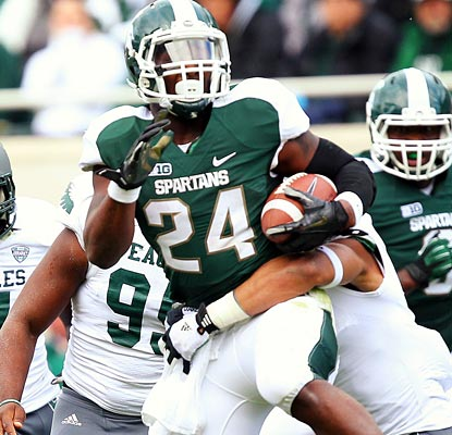 Michigan State puts its offense on Le'Veon Bell's shoulders, and he responds with a career-high 253 rushing yards.  (US Presswire)