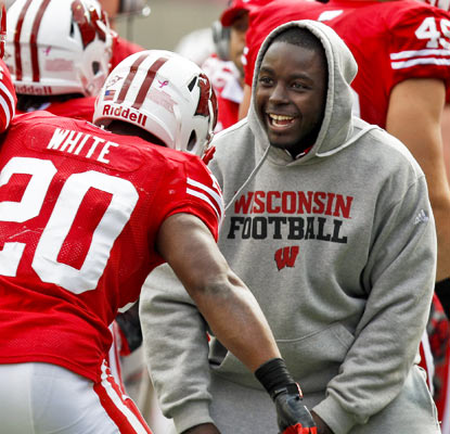 Montee Ball happily waits for James White on the sideline as the Badgers running game picks up the slack in Ball's absence.  (AP)