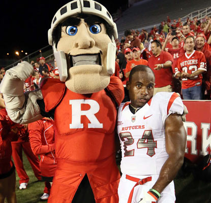 Mason Robinson and the Rutgers mascot celebrate a big win in Arkansas that improves the Scarlet Knights' record to 4-0.  (US Presswire)