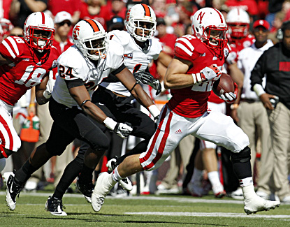 Rex Burkhead runs a touchdown in Nebraska's 73-7 win over Idaho State. (US Presswire)