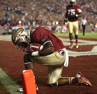 Chris Thompson celebrates one of his two touchdowns in the Seminoles' victory over the visiting Tigers. (Getty Images)