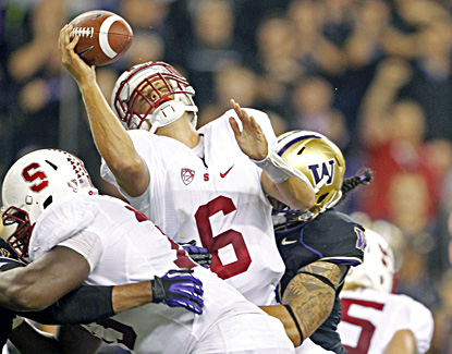 Stanford quarterback Josh Nunes is sacked by Washington linebacker John Timu in the fourth quarter. (US Presswire)