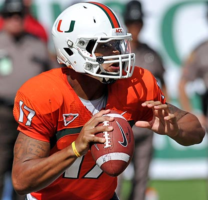 Miami QB Stephen Morris sets ACC and school records with his 566 passing yards, adding five touchdowns.  (US Presswire)