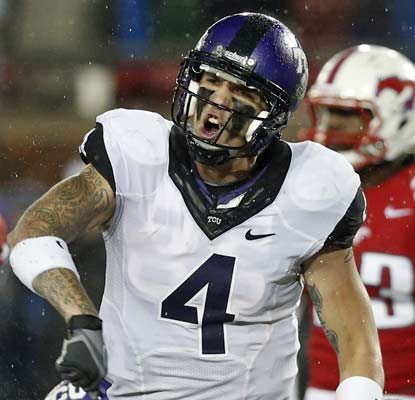TCU's Casey Pachall fights through a heavy rainstorm to toss two touchdowns for the Horned Frogs.  (US Presswire)