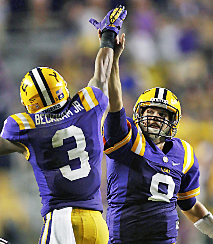 Zach Mettenberger (right) high-fives Odell Beckham after Mettenberger's 53-yard touchdown pass. (AP)