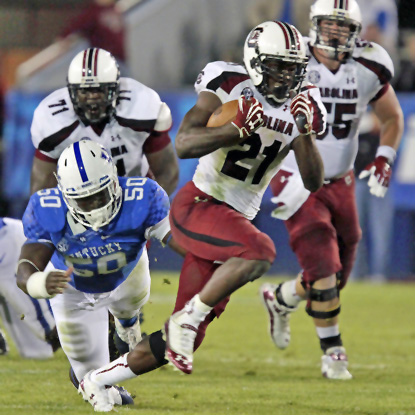 Marcus Lattimore rushes 23 times for 120 yards and two second-half scores for the Gamecocks. (AP)