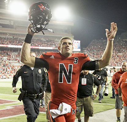 Taylor Martinez and the Huskers escape with a win despite trailing by as many as 17 points against the Badgers. (AP)