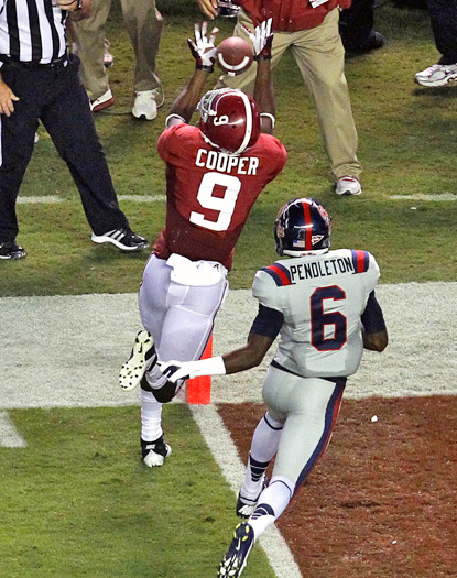Amari Cooper hauls in one of his touchdown catches over Mississippi's Wesley Pendleton. (AP)