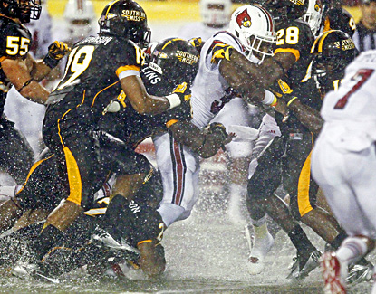 Senorise Perry rushes for 118 yards and two touchdowns in Louisville's win over Southern Mississippi. (AP)