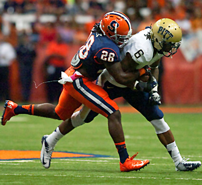 Syracuse's Jeremi Wilkes (left) tackles Todd Thomas and forces a fumble. The Orange recover and return it for a touchdown. (US Presswire)