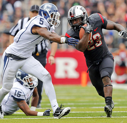 Jawan Jamison helps Rutgers control the ball against UConn, rushing for 110 yards on 28 carries.  (US Presswire)