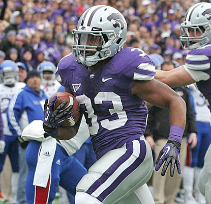 John Hubert leads the charge for Kansas State, rushing for 101 yards and four TDs against the Jayhawks.  (US Presswire)