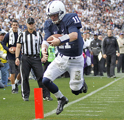 Matt McGloin runs for the go-ahead score after using his arm (school-record 35 completions) to keep PSU in the game.  (Getty Images)