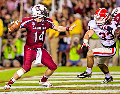 South Carolina's Connor Shaw (left) throws two touchdown passes and runs for another in the win over fifth-ranked Georgia. (US Presswire)
