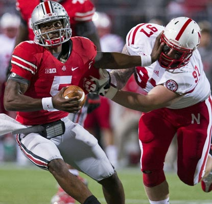 The Cornhuskers can't get a hold on Braxton Miller, who runs wild for 186 yards and a touchdown.  (US Presswire)