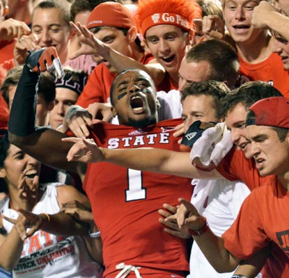 David Amerson and the N.C. State fans celebrate a huge upset win over the visiting Seminoles.  (US Presswire)