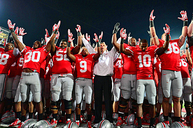 Urban Meyer and his players celebrate following their win over Nebraska at Ohio Stadium. (US Presswire)