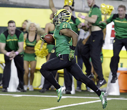 Avery Patterson returns an interception for a touchdown in the first quarter to give the Ducks a 21-0 lead. (AP)