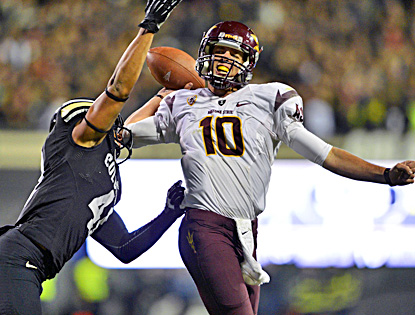 Colorado's Terrel Smith pressures Arizona State's Taylor Kelly during the Sun Devils' 51-17 win.  (US Presswire)
