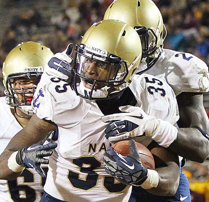 Navy's Prentice Christian celebrates a 2-yard touchdown run for the victorious Midshipmen.  (US Presswire)