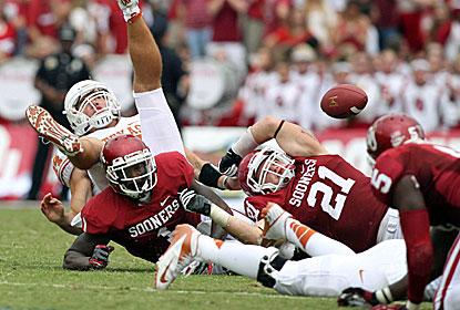 Texas Longhorns quarterback David Ash (14) fumbles the ball in the third quarter against the Oklahoma Sooners. (US Presswire)