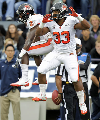 Wide receiver Markus Wheaton (2) celebrates one of his three touchdowns against BYU. (AP)