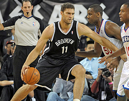 Brooklyn Nets center Brook Lopez drives against Philadelphia forward Lavoy Allen (50) in their game in Atlantic City. (US Presswire)