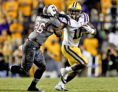 Spencer Ware, who rushes for 55 yards, stiff-arms South Carolina's D.J. Swearinger in the Tigers' win. (US Presswire)