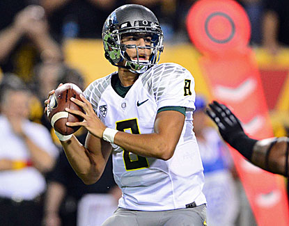Freshman QB Marcus Mariota throws for one touchdown, runs for another and has one receiving. (US Presswire)